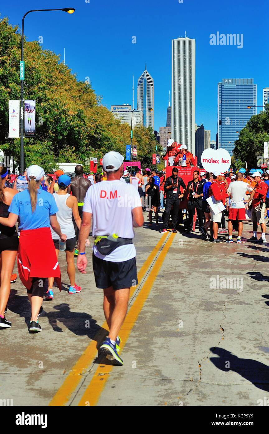 Shortly after crossing the finish line at the 2017 Chicago Marathon, runners make their way down Columbus Drive - Stock Image