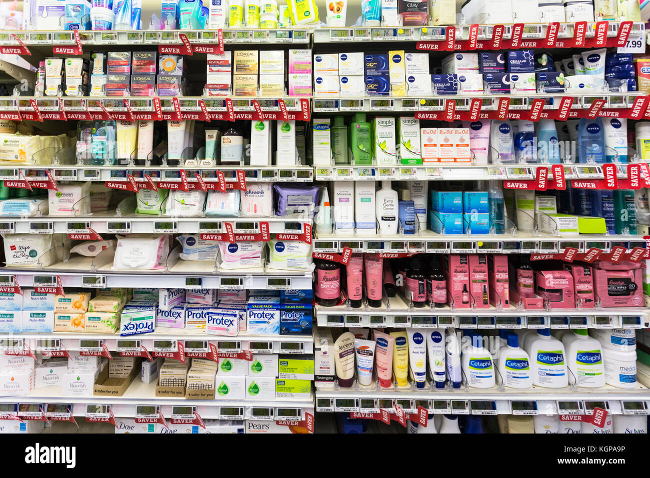 WELLINGTON, NEW ZEALAND - MARCH 1, 2017: Cosmetic and other women hygiene products are displayed in a supermarket - Stock Image