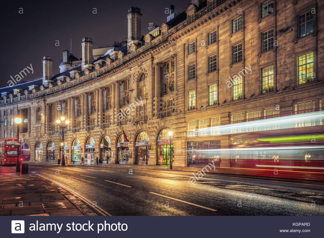 Regent Street in London is ever busy. Even early in the morning, before the Underground has opened, the double decker - Stock Image