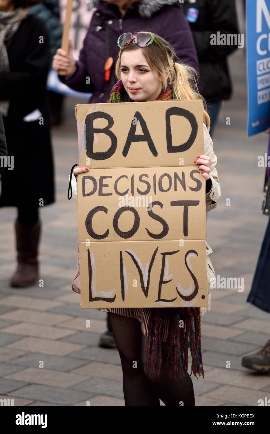 Bad decisions cost lives placard during Our NHS protest demonstration rally march against alleged UK Tory Conservative - Stock Image