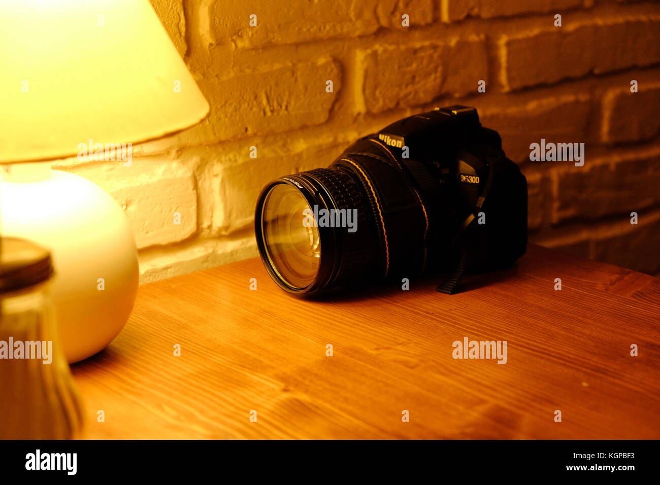 The Nikon camera rests on the table in the cafe after the photo walk - Stock Image