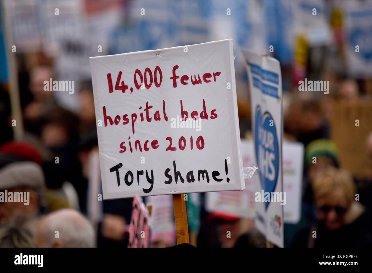 Fewer hospital beds since 2010 placard during Our NHS protest demonstration rally against alleged UK Tory Conservative - Stock Image