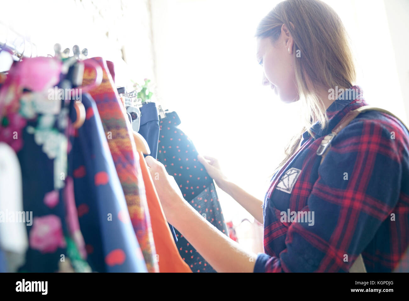 Woman in clothing store, shopping day - Stock Image