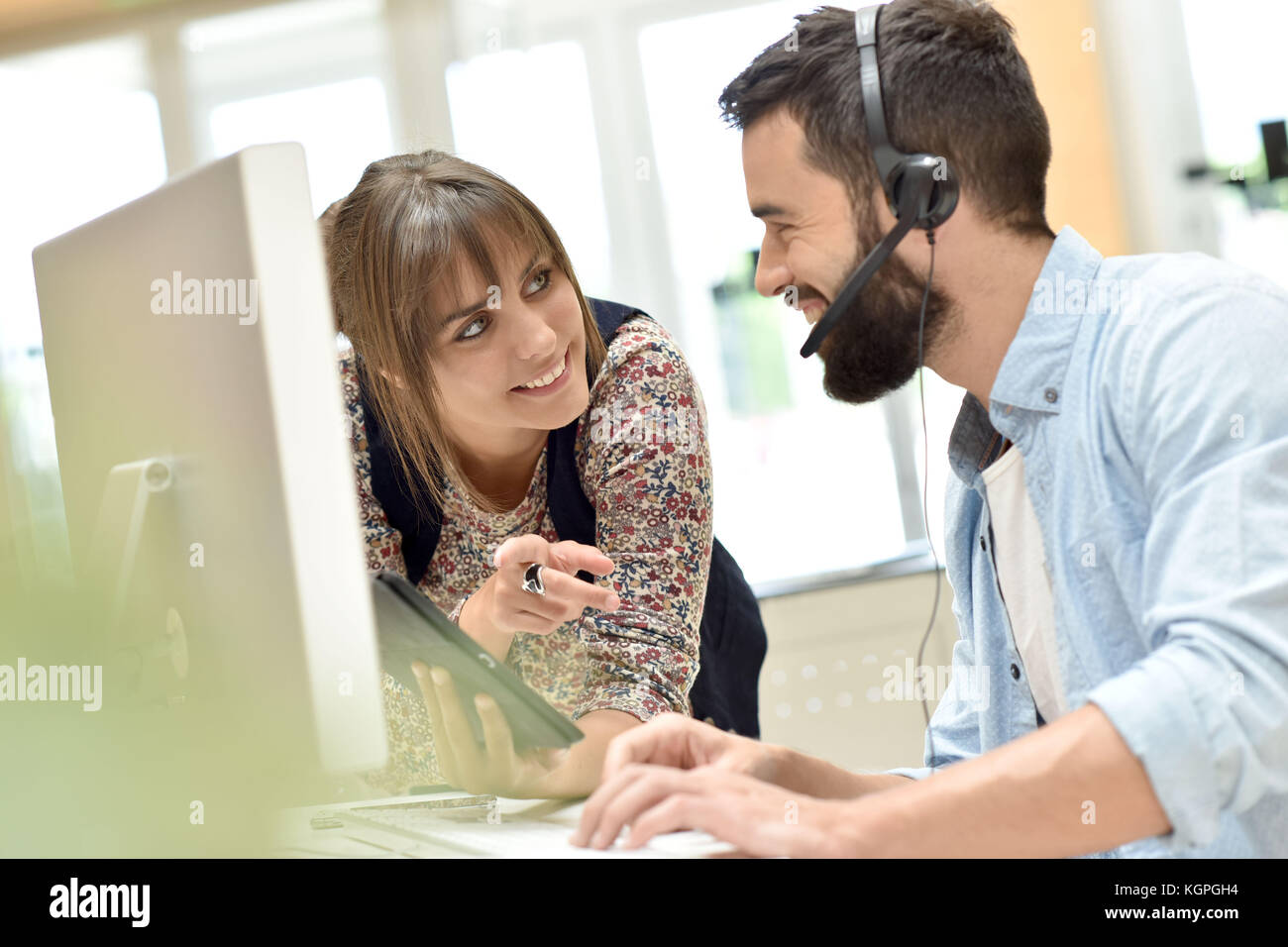 Telemarketing people working together in office Stock Photo