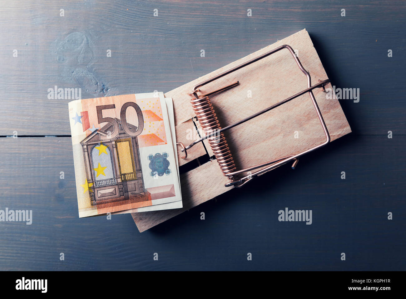 risky money - euro bill in mouse trap - Stock Image