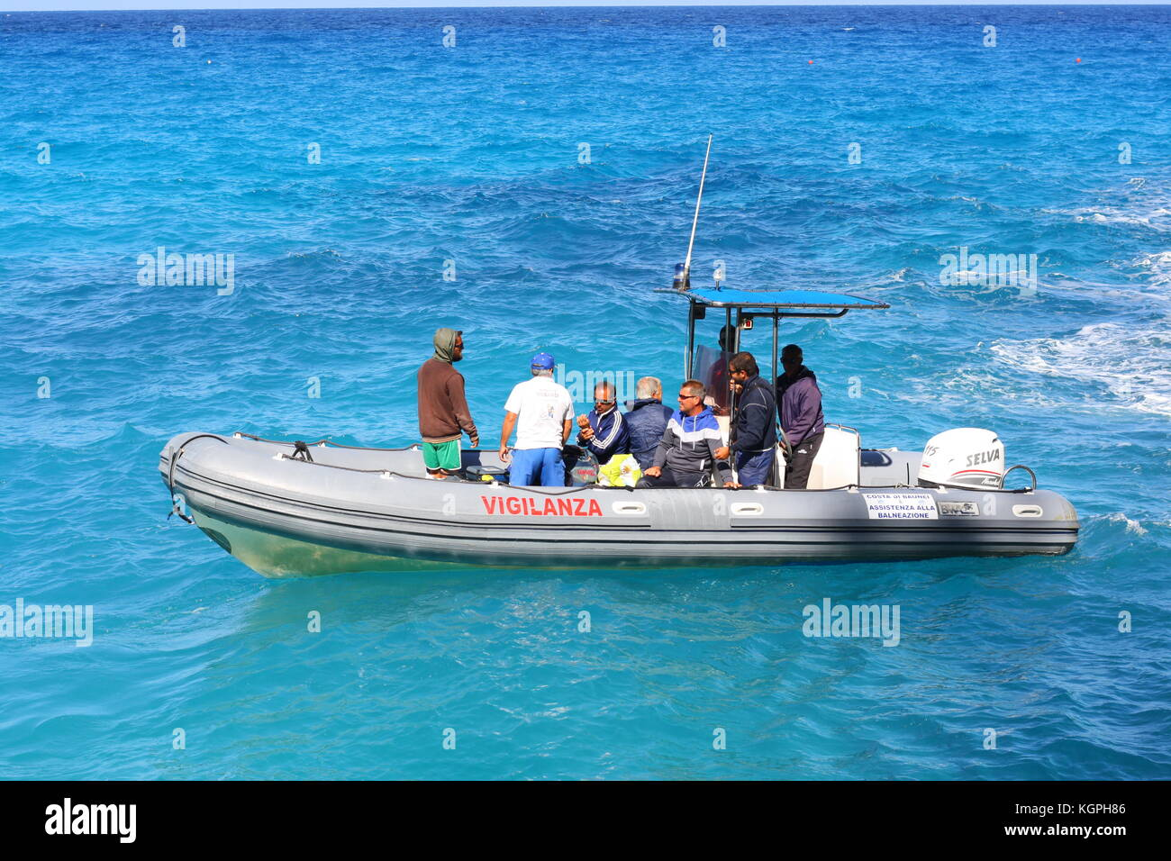 A small inflatable Vigilanza boat on blue sea water in Sardinia, Italy - Stock Image