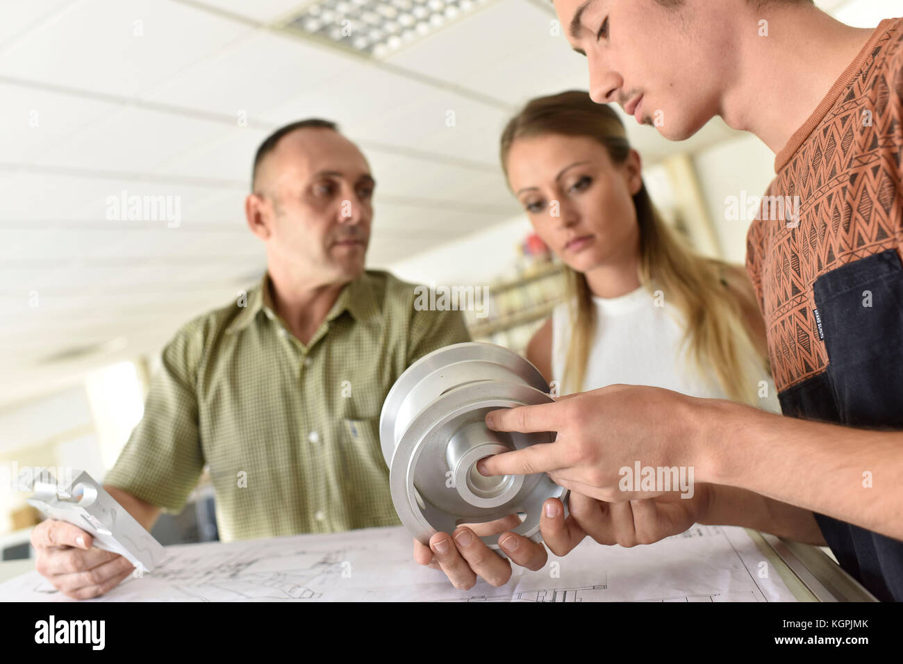Young people in engineering training class - Stock Image