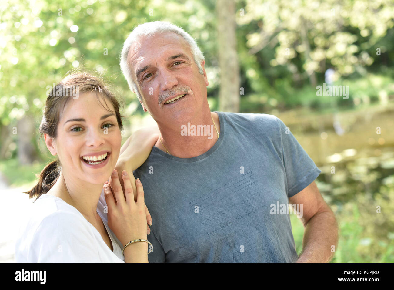 Portrait of man with daughter - Stock Image