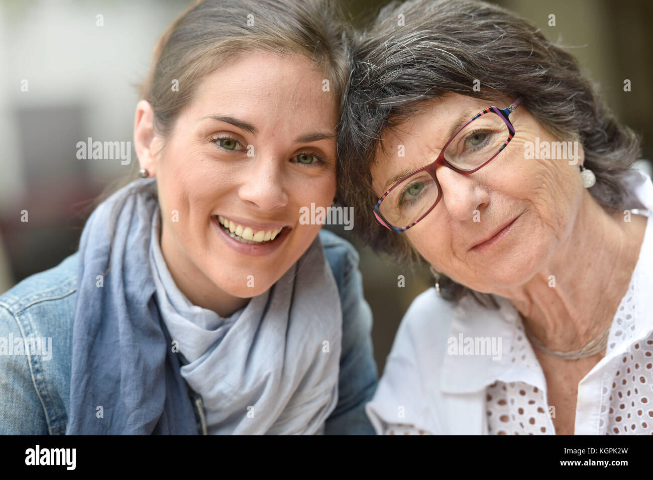 Portrait of elderly woman with home carer - Stock Image