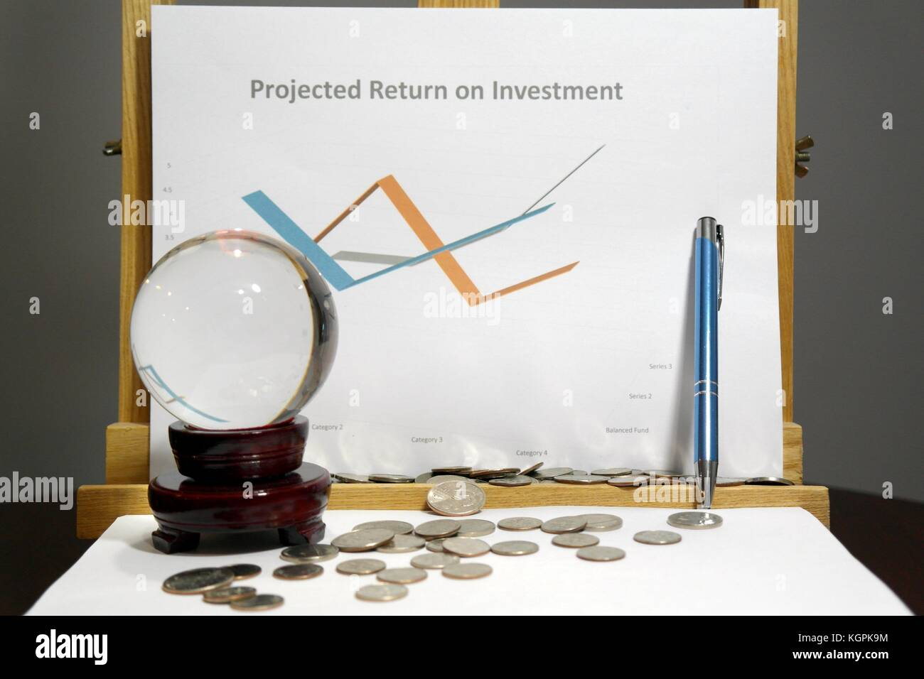 Crystal ball in front of a graph predicting return on investment - Stock Image