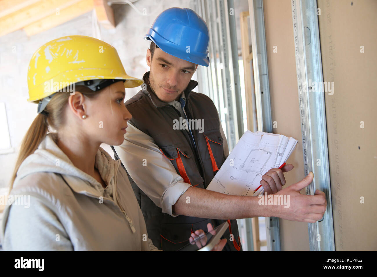 Young woman in professional training on building site - Stock Image