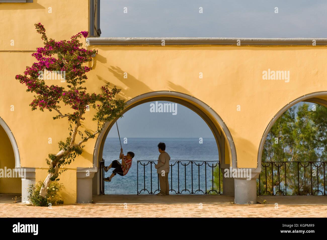 Greece, Aegean Islands, Karpathos island, City hall playground in Pigadia Stock Photo