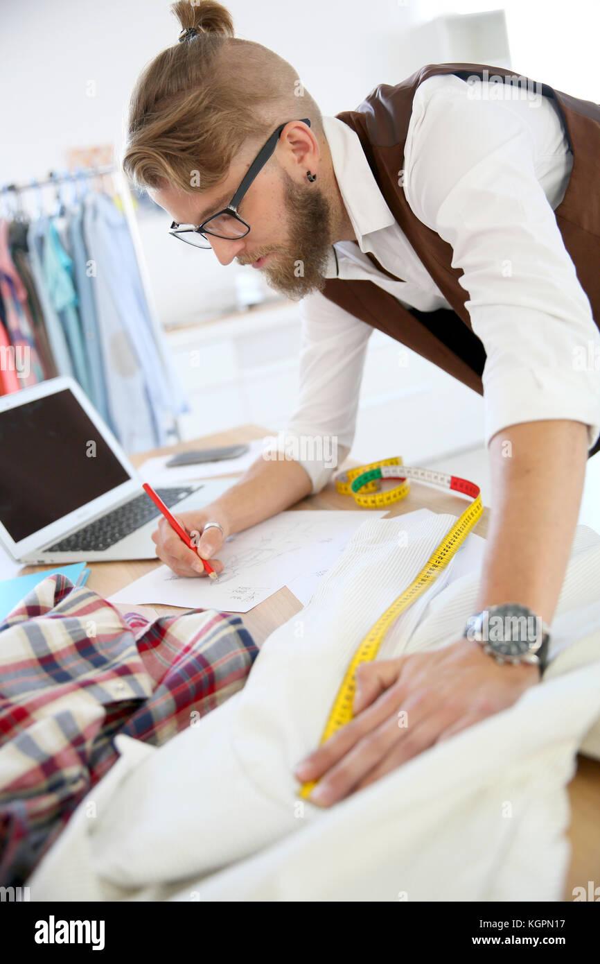 Fashion designer in workshop - Stock Image