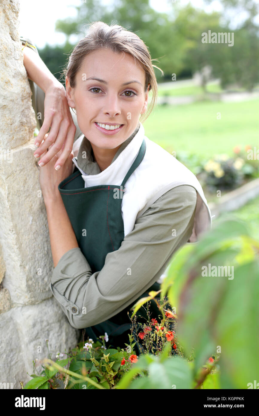Portrait of young woman gardener - Stock Image