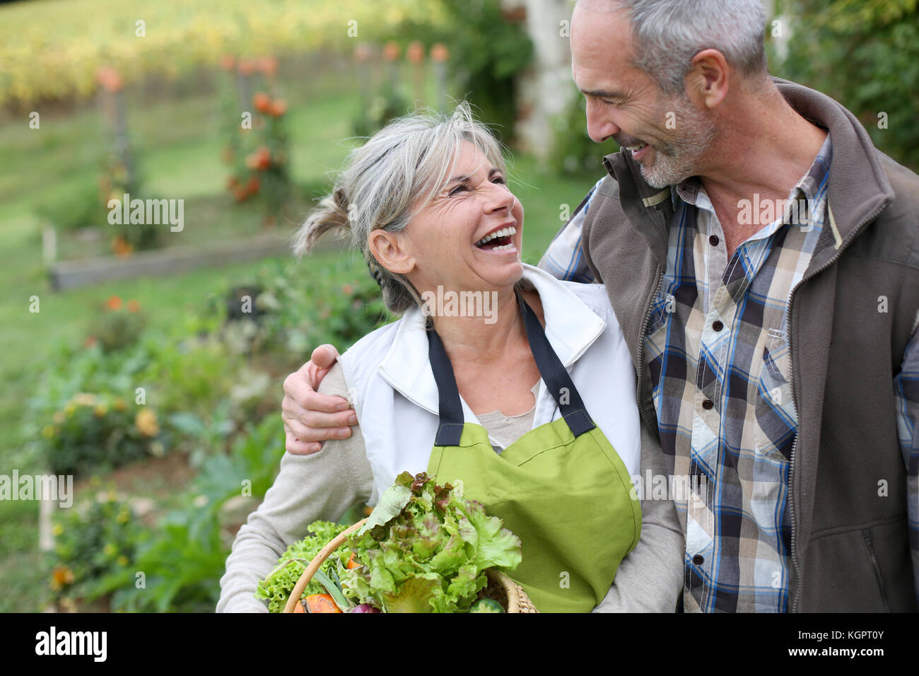 Husband and wife enjoying being in kitchen garden Stock Photo