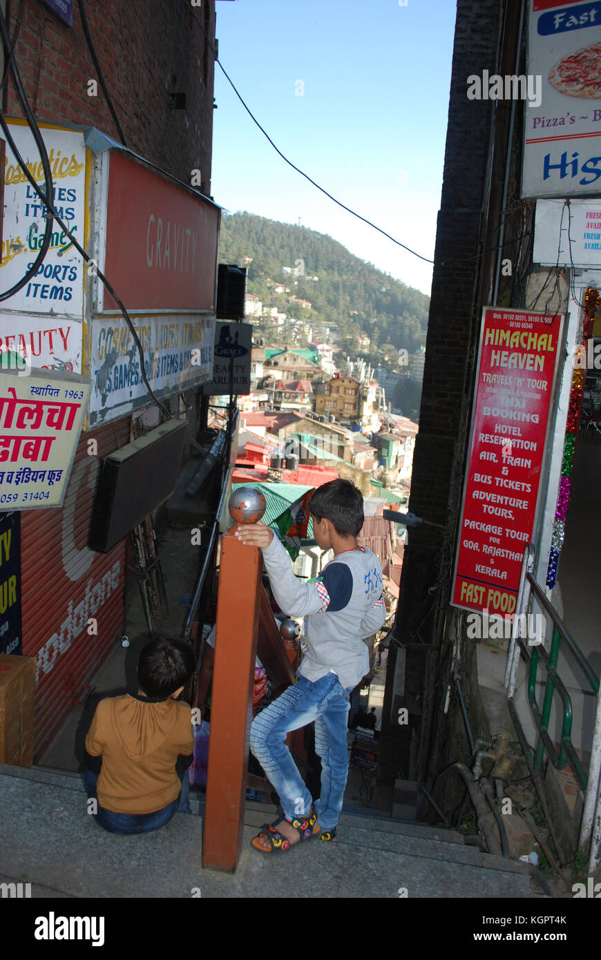 Little boys playing at the top of the stairs in  Shimla (Simla) , Himachal Pradesh,  India - Stock Image
