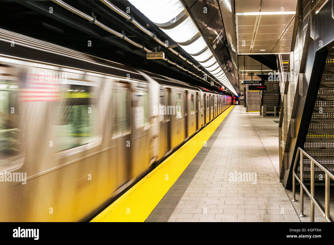 sew york subway train New york usa new york subway train moving through a subway station new york city usa - Stock Image