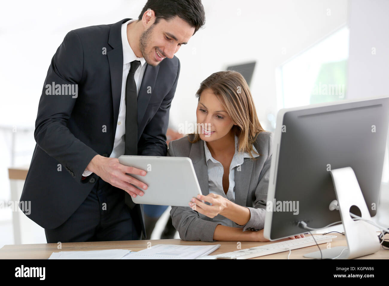 Business people in office working on tablet - Stock Image