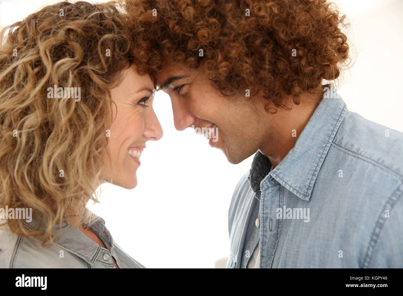 In love couple looking at each other's eyes - Stock Image