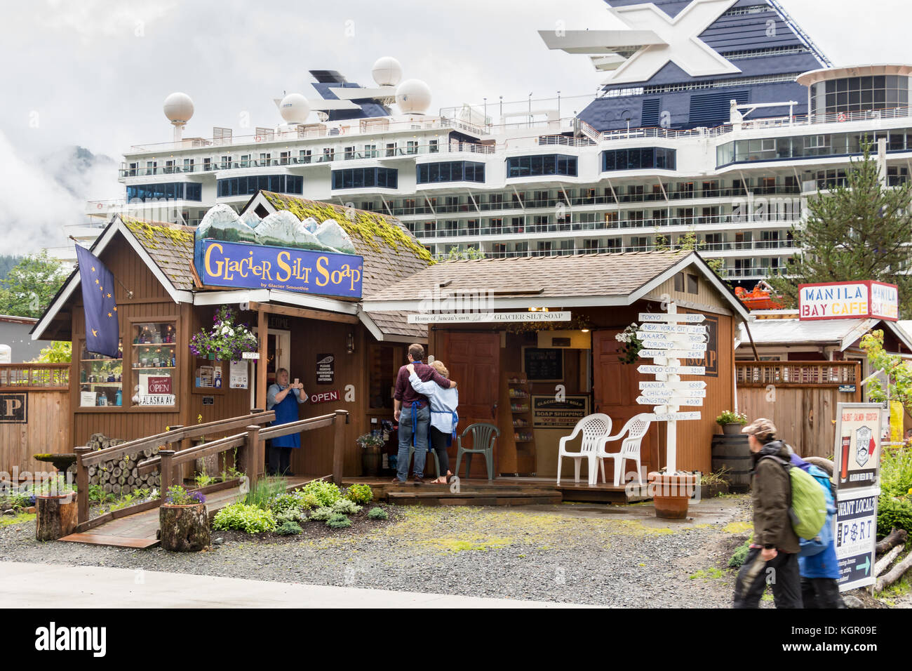 Juneau, Alaska, USA - July 28th, 2017: Employees of the Glacier Silt Soap shop are taking photos with a mobile outside - Stock Image