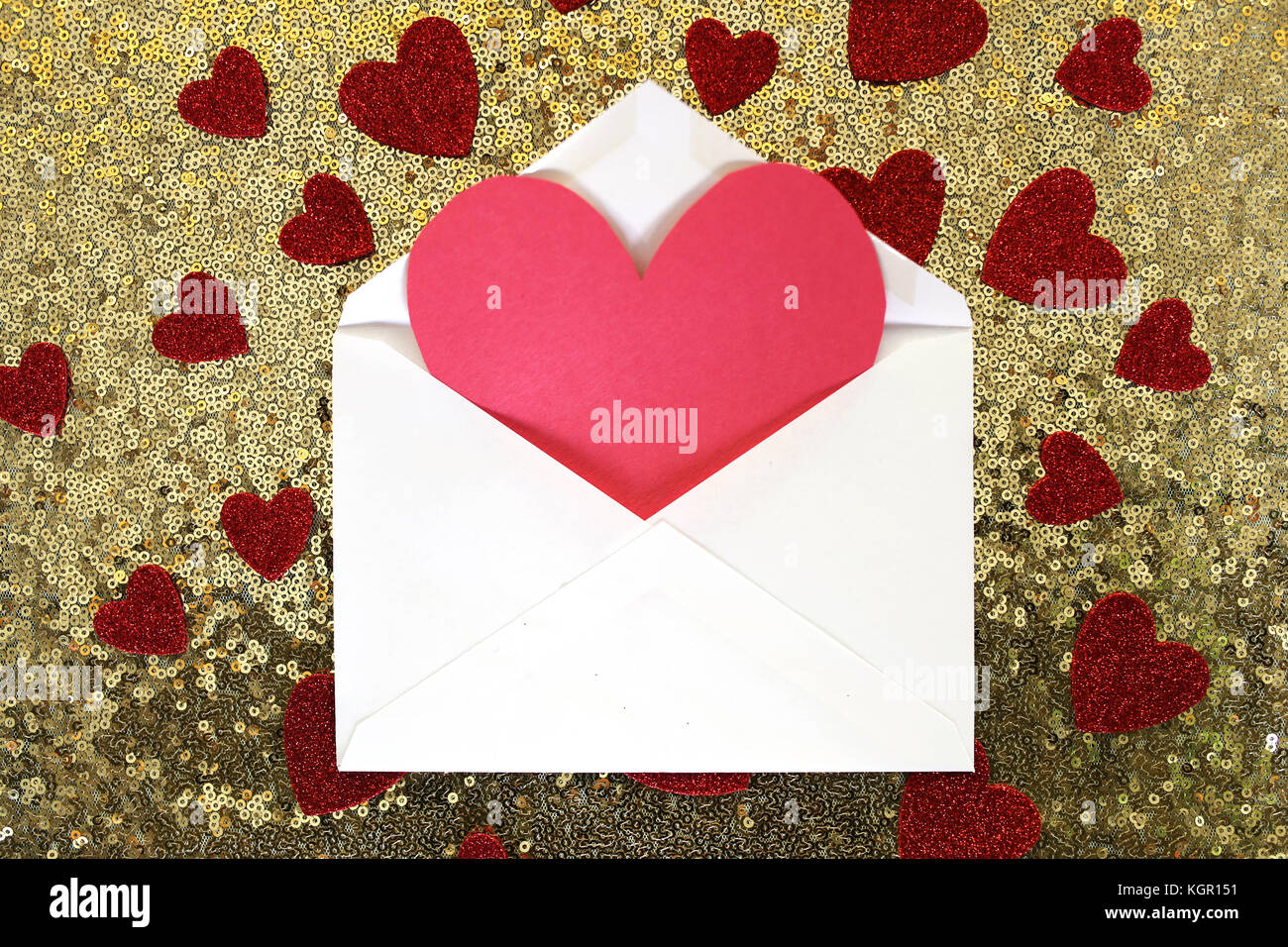 An Envelope With A Blank Red Valentines Day Card In It Is On Gold Sequin Background Surrounded By Sparkly Heart Confetti