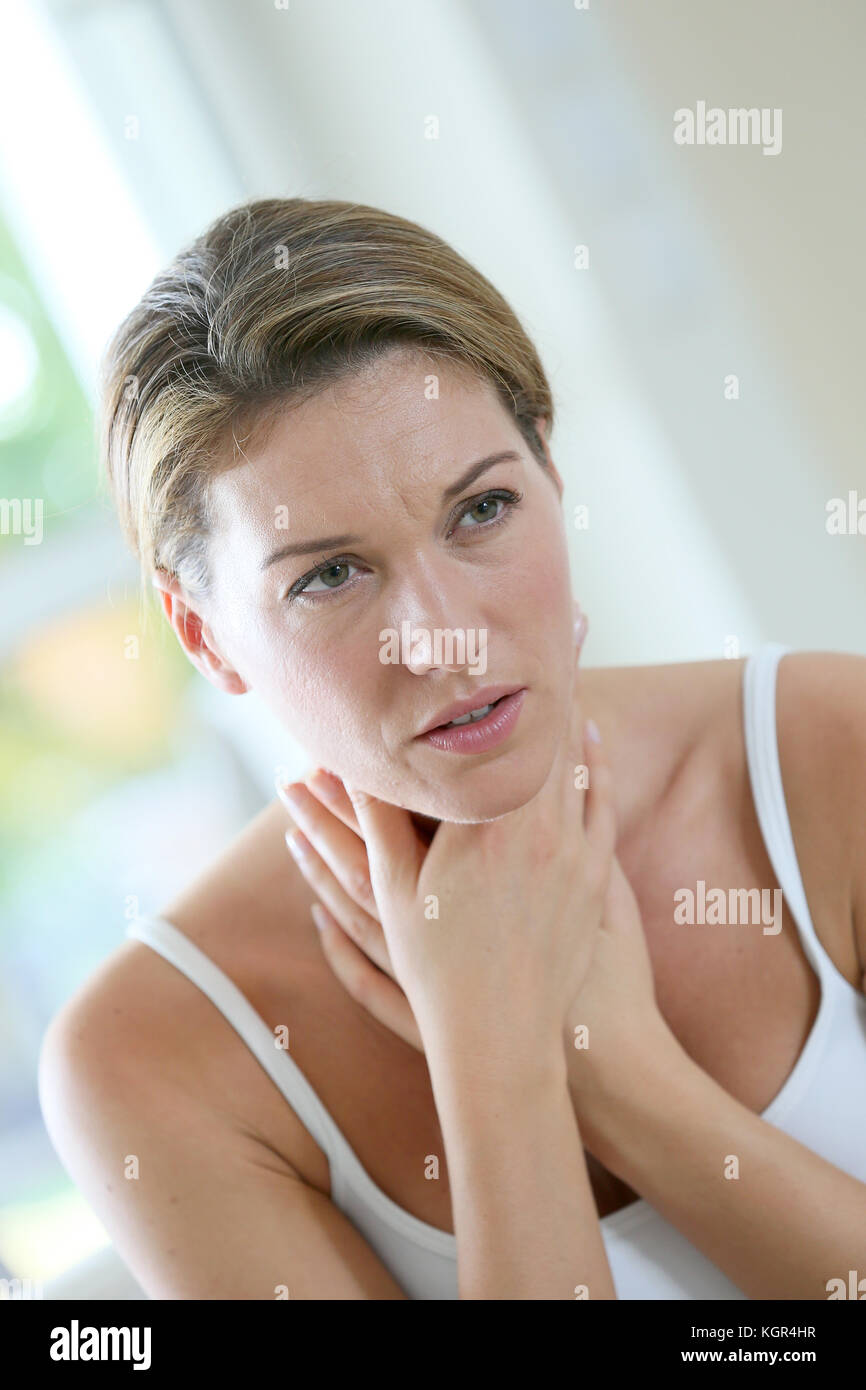Middle-aged woman having a cold and coughing - Stock Image