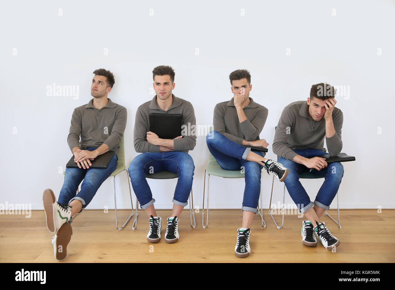 Youn man in waiting room for job interview - Stock Image