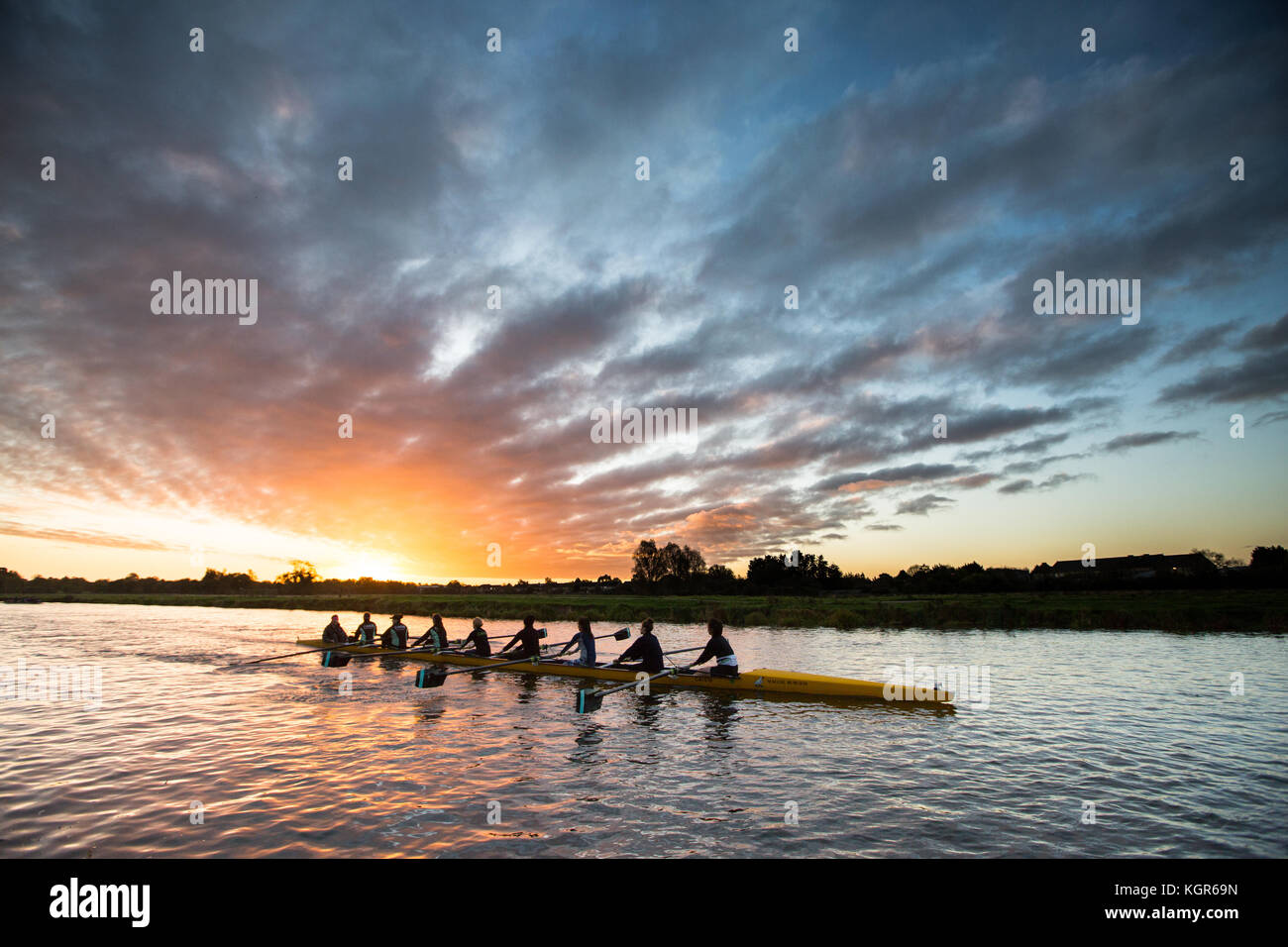 Cambridge University students rowing on the River Cam in Cambridge at sunrise on a sunny but cold start to the day - Stock Image