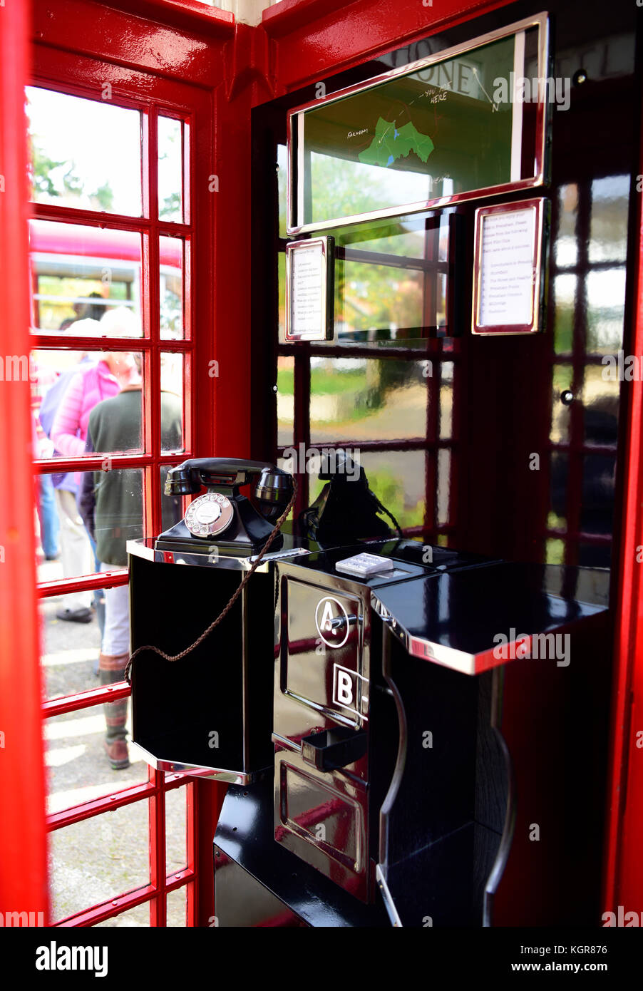 Interior of a refurbished traditional red phone box which has been converted into a small visitors centre. The interior - Stock Image
