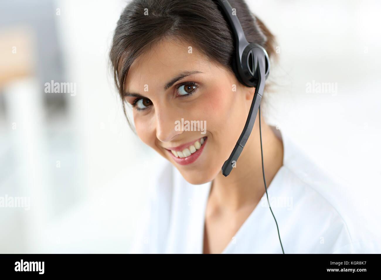 Portrait of medical secretary typing report - Stock Image