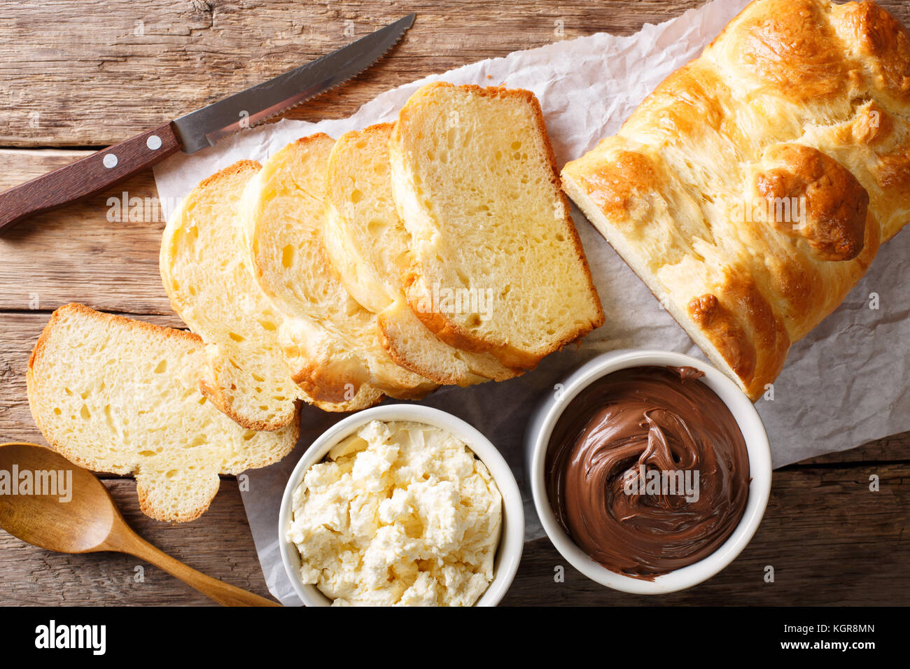 French brioche bread and cream mascarpone cheese, chocolate cream close-up on the table. horizontal top view from - Stock Image