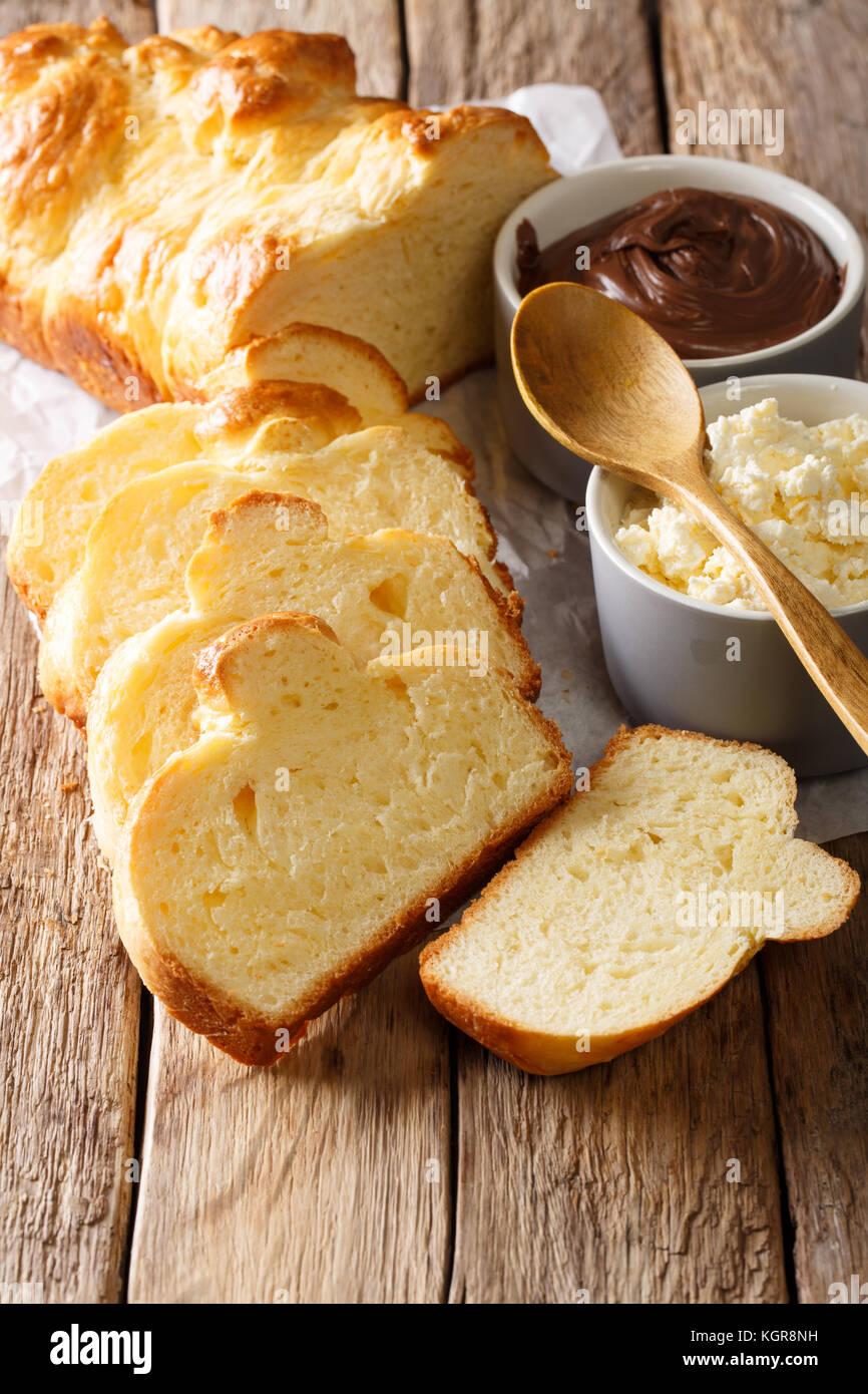 French brioche bread and cream mascarpone cheese, chocolate cream close-up on the table. vertical - Stock Image
