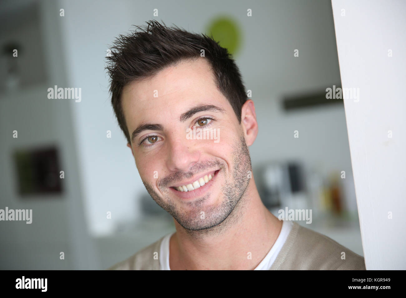 Portrait of smiling attractive man - Stock Image