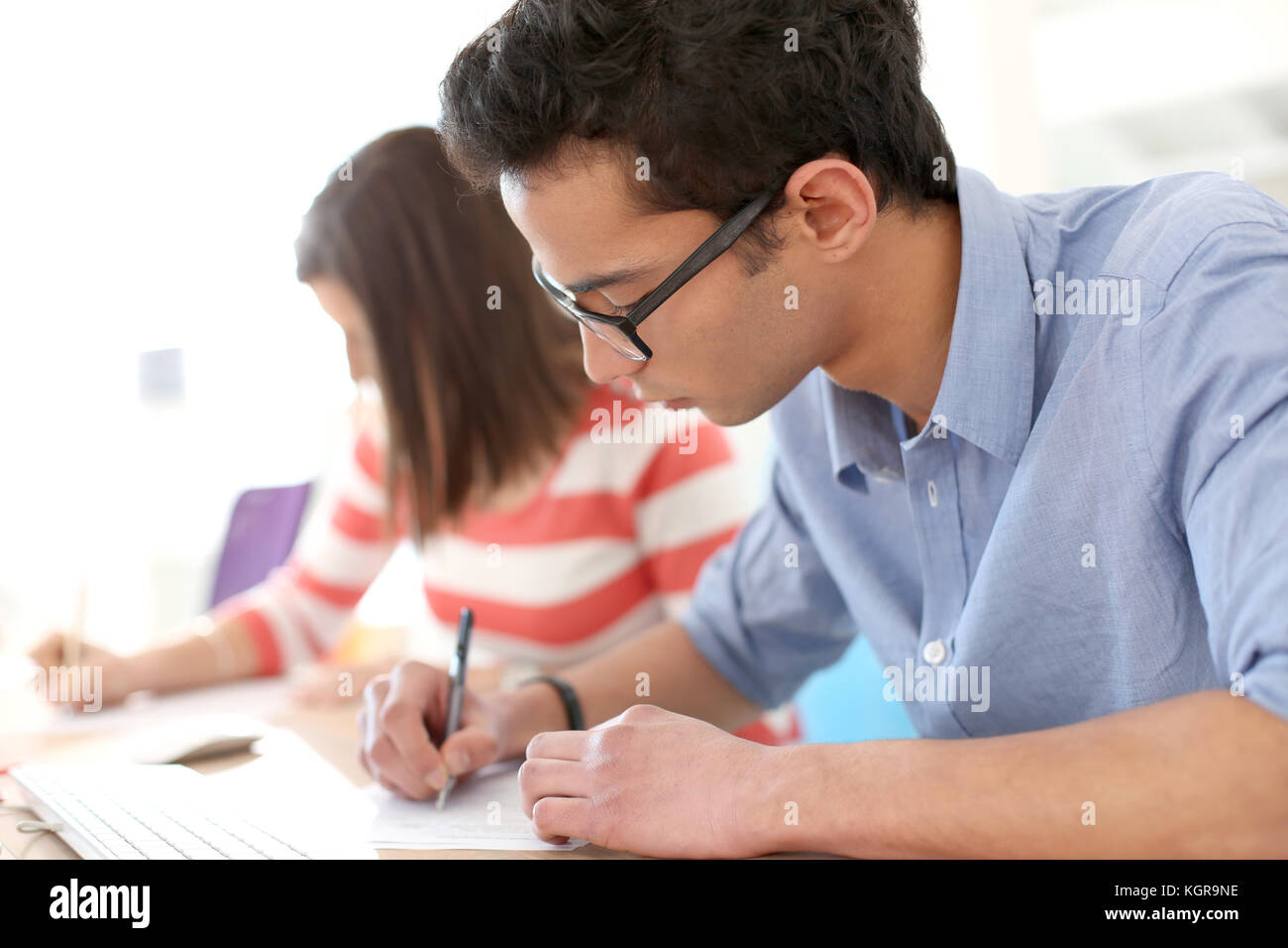 Student filling application form for business school Stock Photo