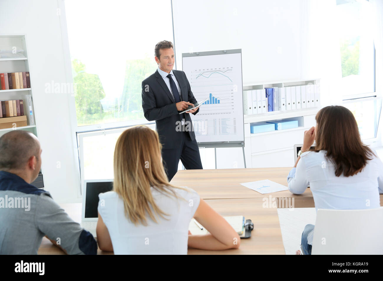 Business people attending weekly presentation - Stock Image