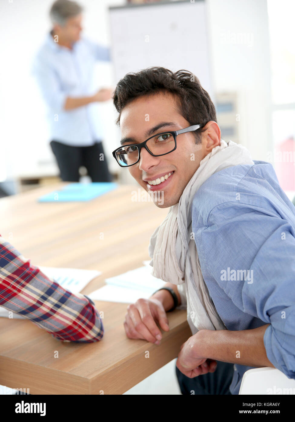 Portrait of student in conference room - Stock Image