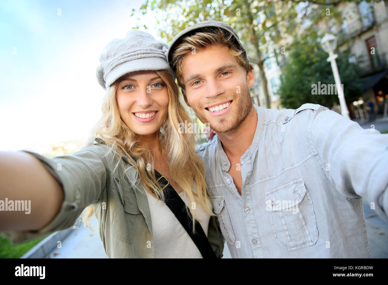 Cheerful trendy couple taking self-portrait picture Stock Photo