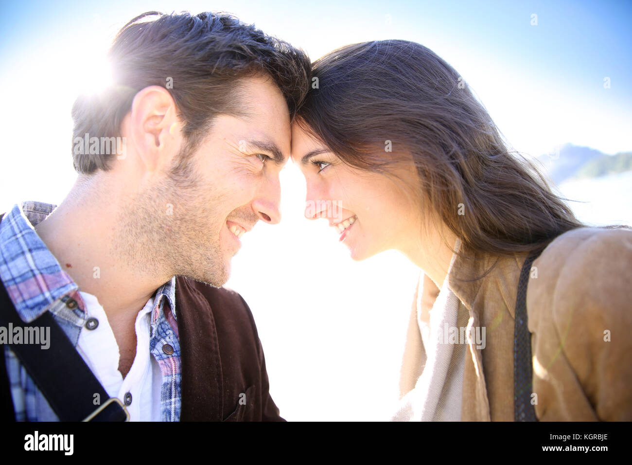 Sweet couple looking at each other's eyes - Stock Image
