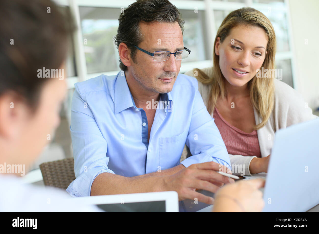 Business people meeting and using digital tablet - Stock Image