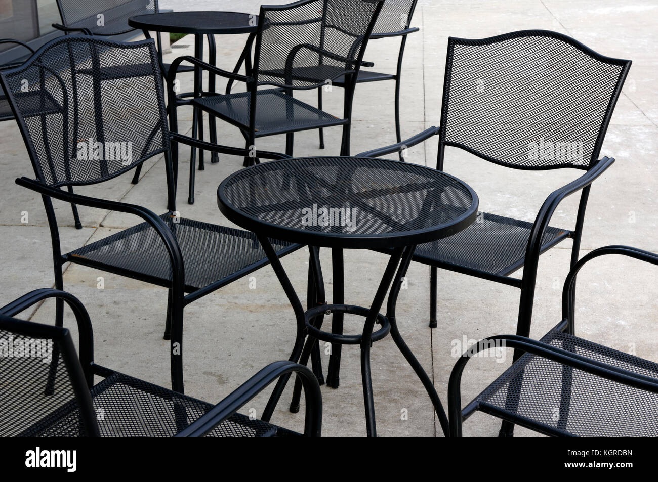Fancy black metal outdoor furniture chairs and tables stock image