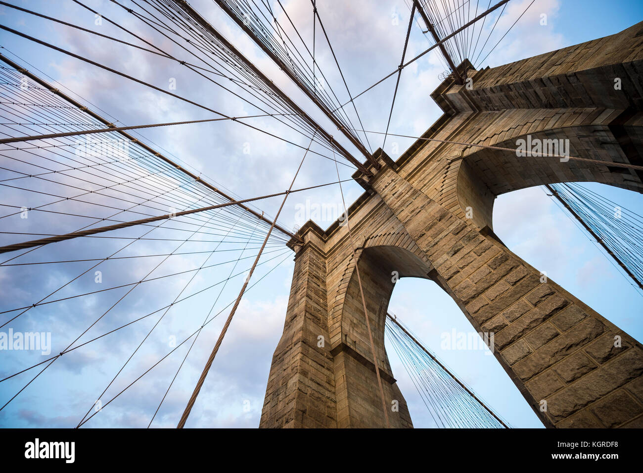 Architectural close-up detail of the landmark Brooklyn Bridge in New York City with its iconic steel cables making - Stock Image