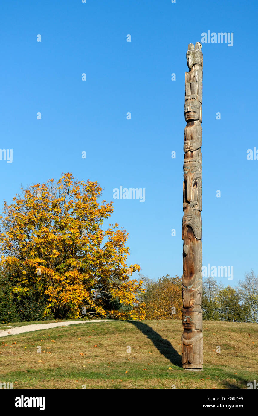 West Coast First Nations totem pole and tree with fall foliage at the UBC Museum of Anthropology, Vancouver, BC, - Stock Image