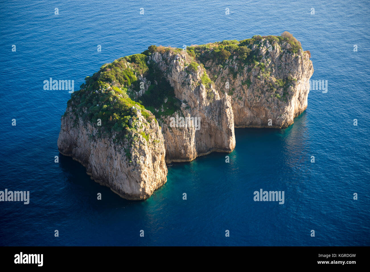 Dramatic overhead view of the iconic Faraglioni rocks, just off the shore of the island of Capri, Italy - Stock Image