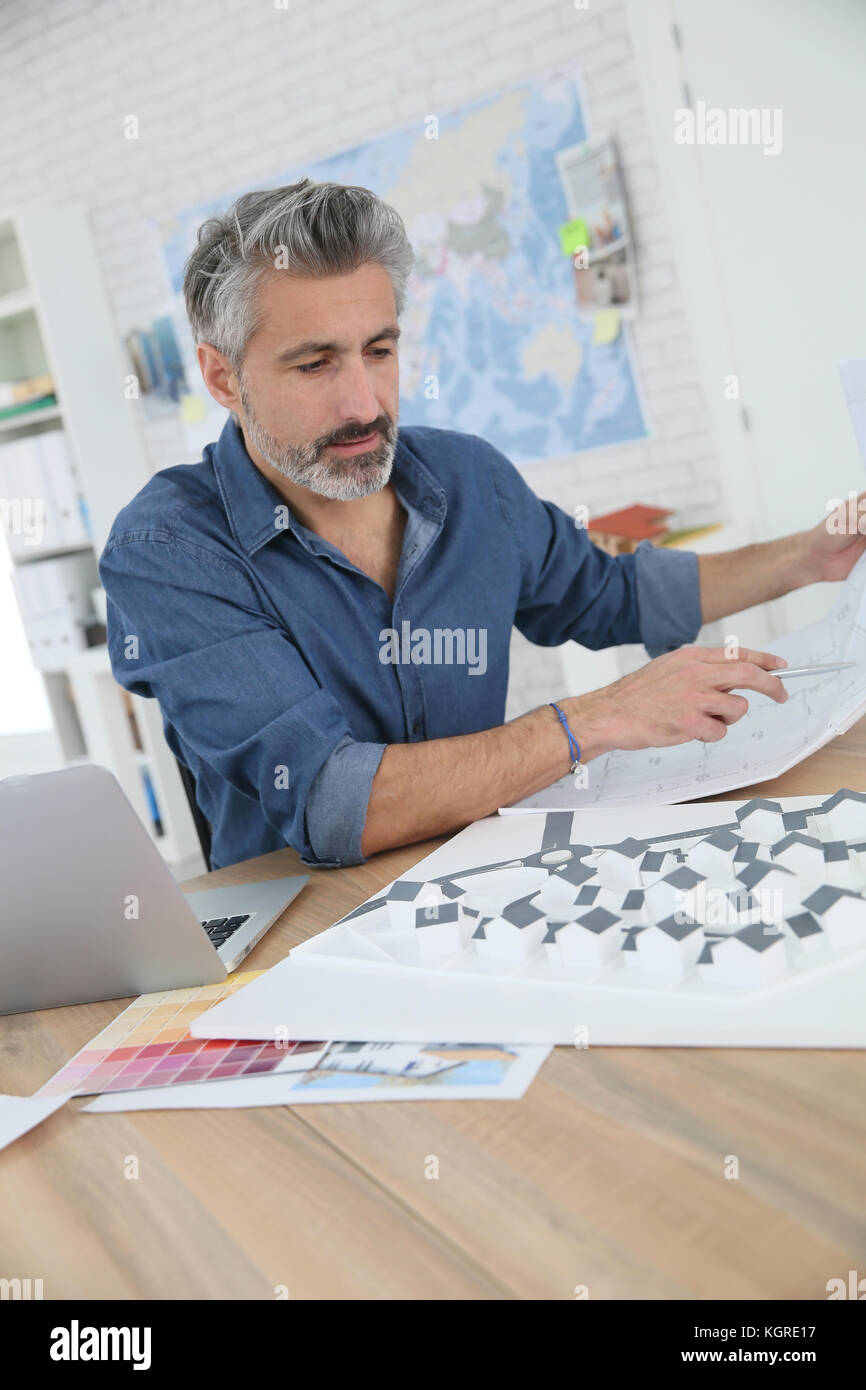 Porrtait of smiling architect in office - Stock Image