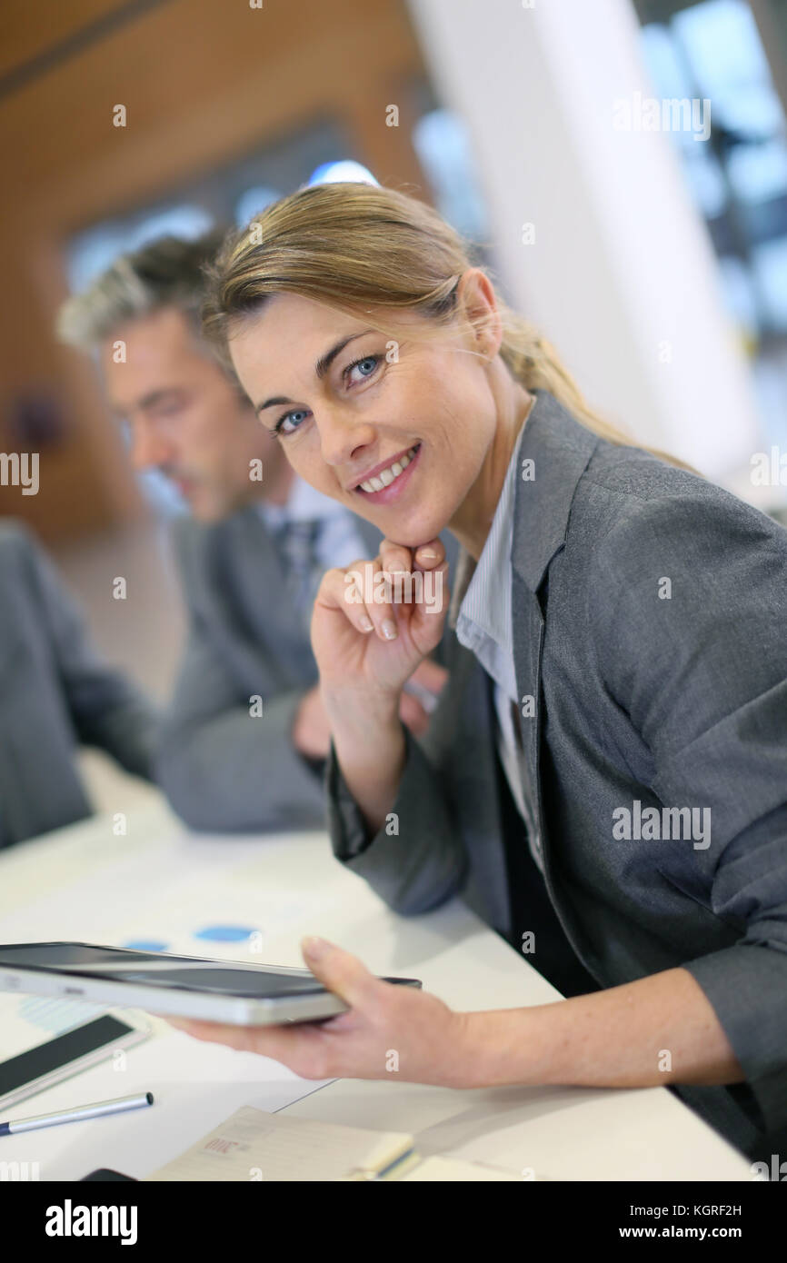 Portrait of executive woman in business meeting - Stock Image