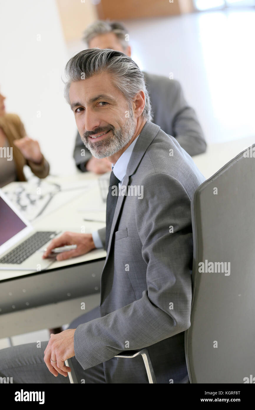 Portrait of architect meeting with clients in office - Stock Image