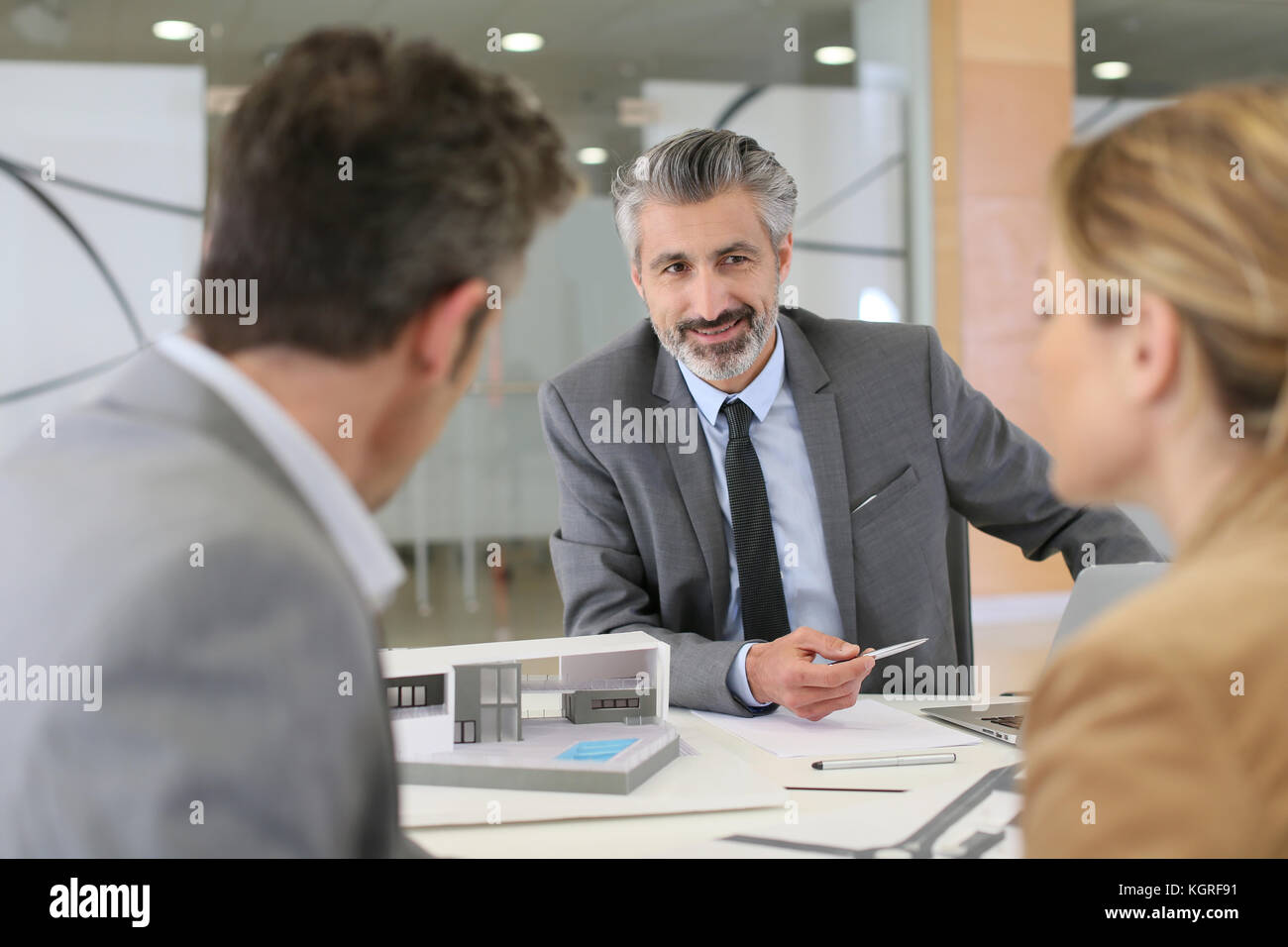 Architect meeting with clients in office Stock Photo