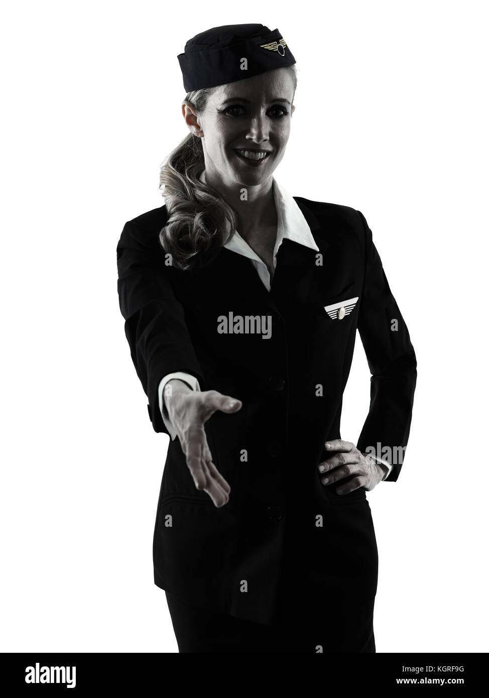 one caucasian Stewardess cabin crew  woman Handshaking isolated on white background in  silhouette - Stock Image