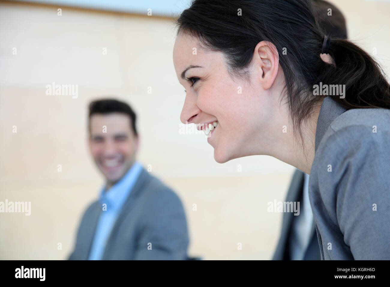 Young smiling saleswoman - Stock Image