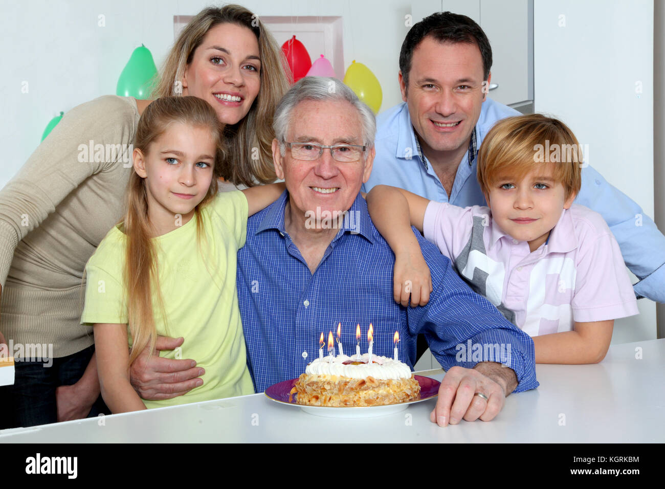 Family Celebrating Grandfathers Birthday